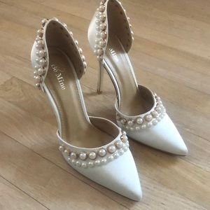 White pearl pumps